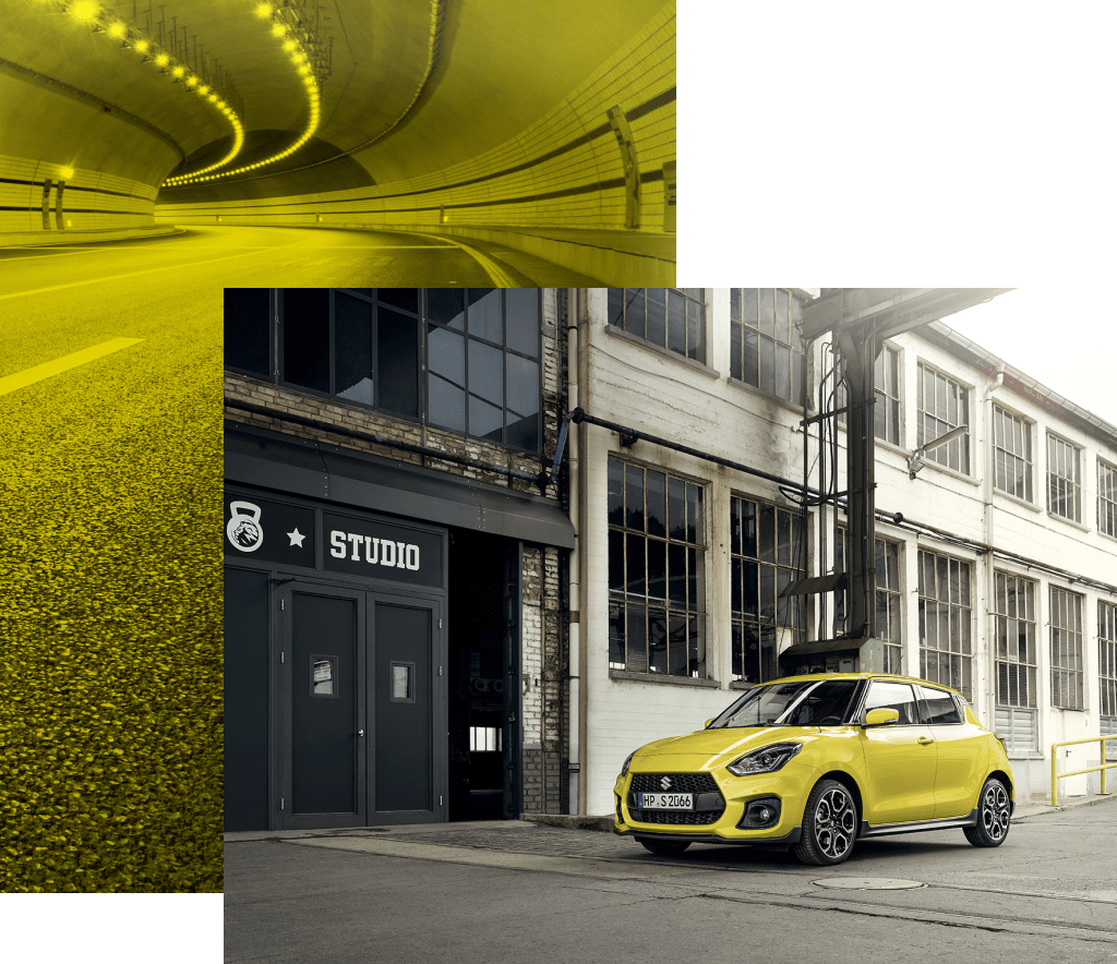 Suzuki Swift Sport Hybrid in Champion Yellow steht vor einem Studio.